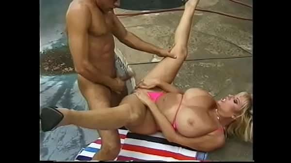 Blonde bombeshell with huge bazongas Kimberly Kupps prefers to spend her week-end near the pool getting her buns splitted with massive pole